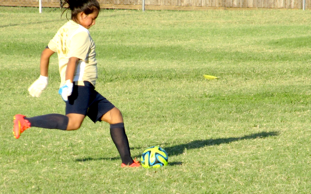 Young girl pictured playing football. Photo: pxfuel